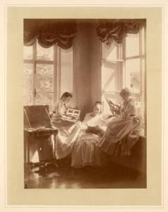 Three_girls_with_photograph_albums