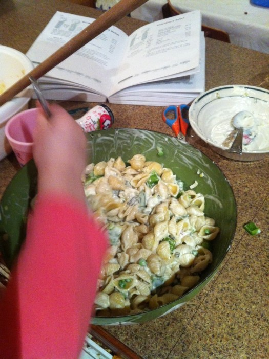And here she is mixing the salad - you can pretty much see the end product here. It's ... a pasta salad.