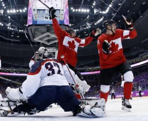 Jamie Benn scoring against USA in semifinals  Photo from here: http://lens.olympic.ca/a/tw-436943919444537344
