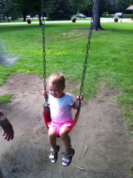 Our youngest on the big kid swing for the first time.