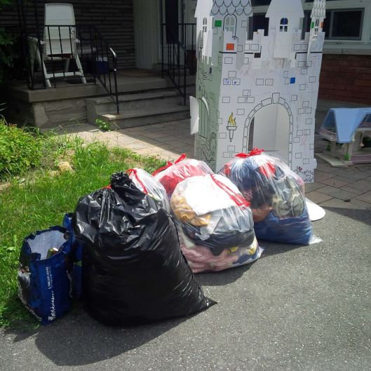 Five bags for donation - staged in front of the girls' chateau, which needed to be moved outside for cleaning purposes.