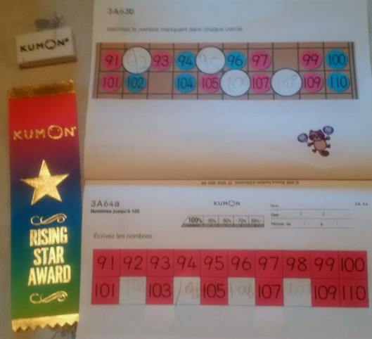 """The Rising Star Award is giving for """"beginning your academic journey with Kumon"""". As for the homework? This week we did numbers over 100 for the first time and next week we ACTUALLY START ADDITION."""